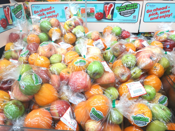 Blemished fruits and veggies are packaged and sold at reduced prices.