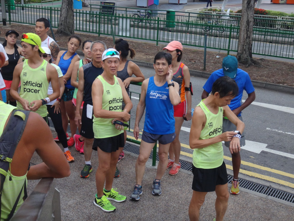 Runners set their GPS watches before taking off.
