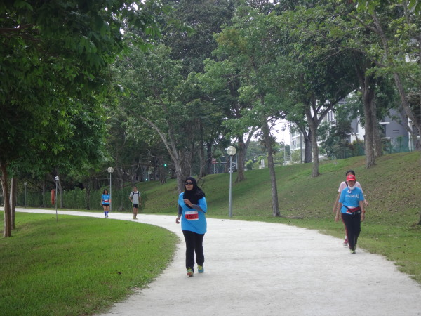 Runners braving the heat at Bedok Reservoir Park.