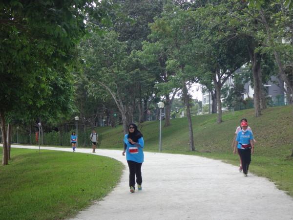 Runners braving the heat at Bedok Reservoir Park.