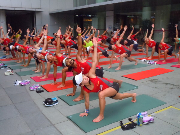 A yoga session was one of the many fun activities at the OSIM Sundown Marathon event launch.
