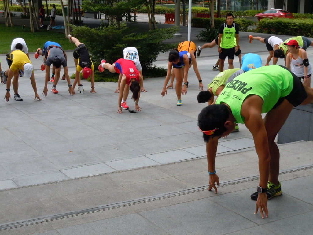 An Earth Runners pacer leads the participants through warm-up exercises.