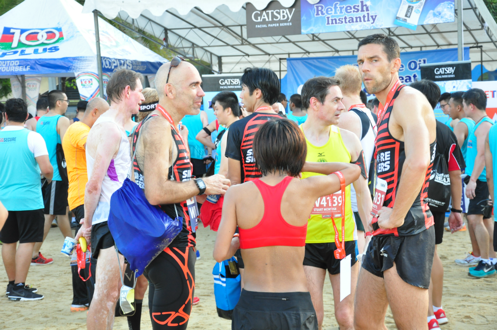 Runners congregate at the post race village.