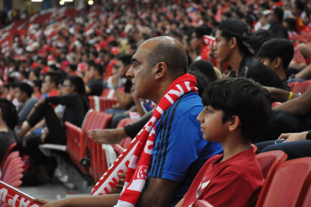 A father and his young son at the game.