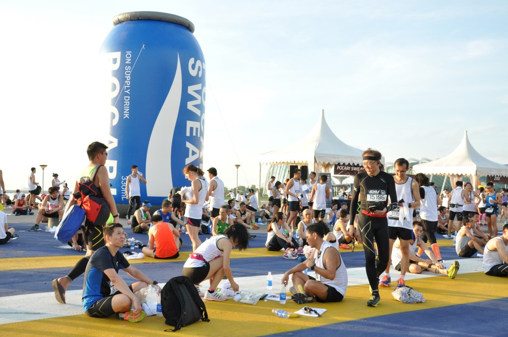 Relaxing at the race village with the large Pocari Sweat can as a backdrop.