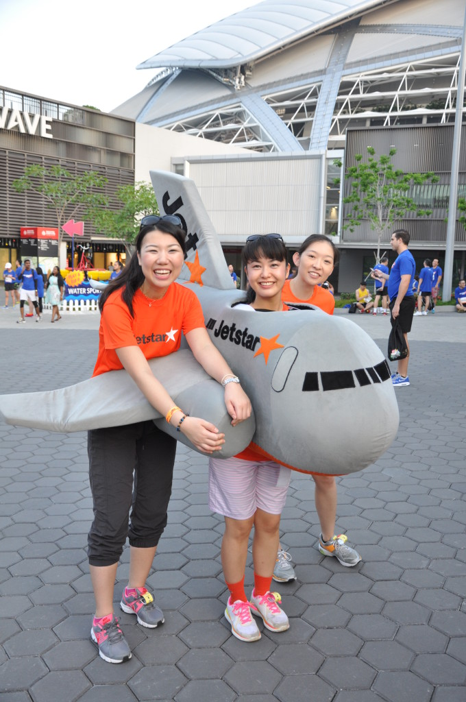 A girl poses with an airplane costume.