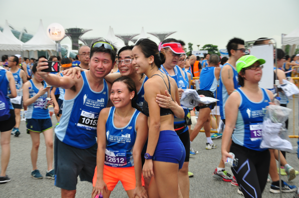 Runners taking a post-race wefie together.