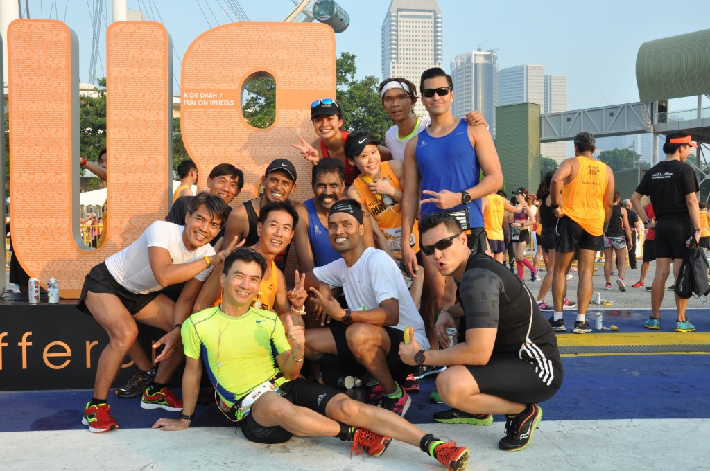 Runners pose for a photo after their run.