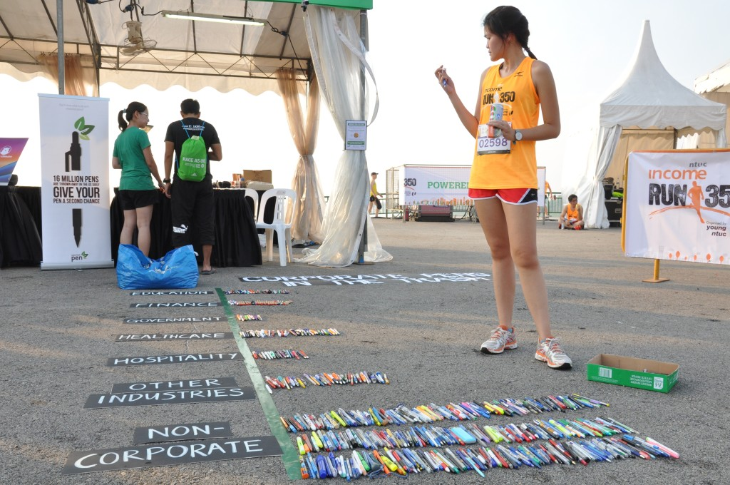 Runners sorted out some pens, in another green activity at the race village.