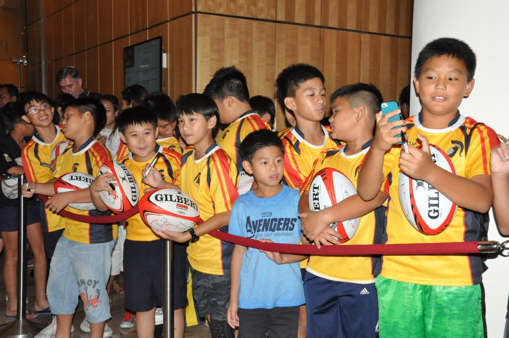 Eager young rugby fans look forward to seeing their idols.