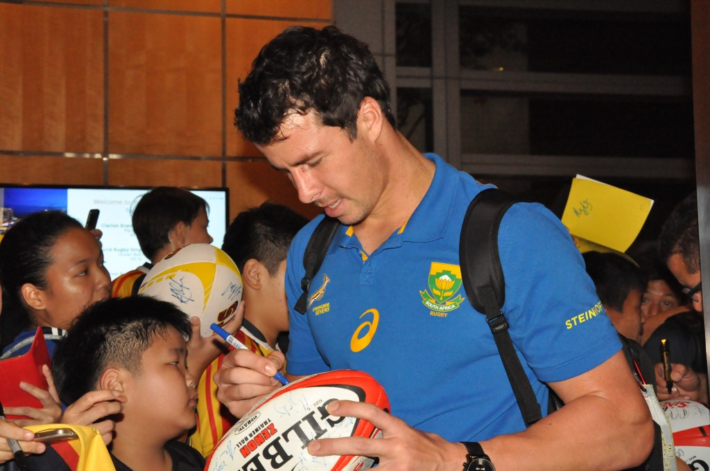 An eager young rugby fan gets his ball signed.