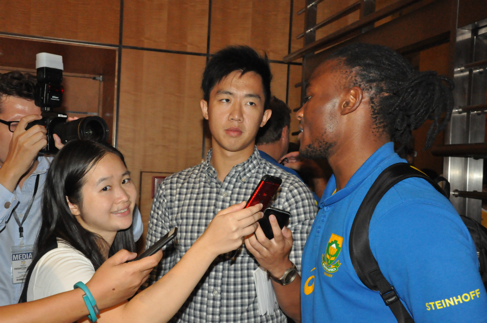 Seabelo [right], being interviewed here by the media, feels that the humid weather may affect play in Singapore.