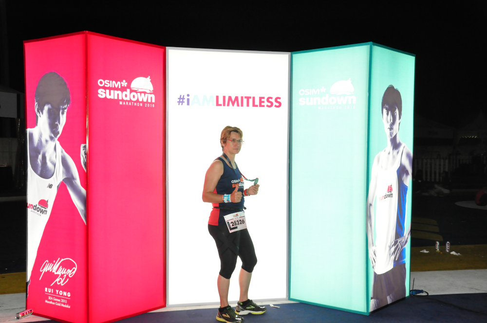 A runner poses with a mural of Sundown Marathon ambassador Soh Rui Yong.