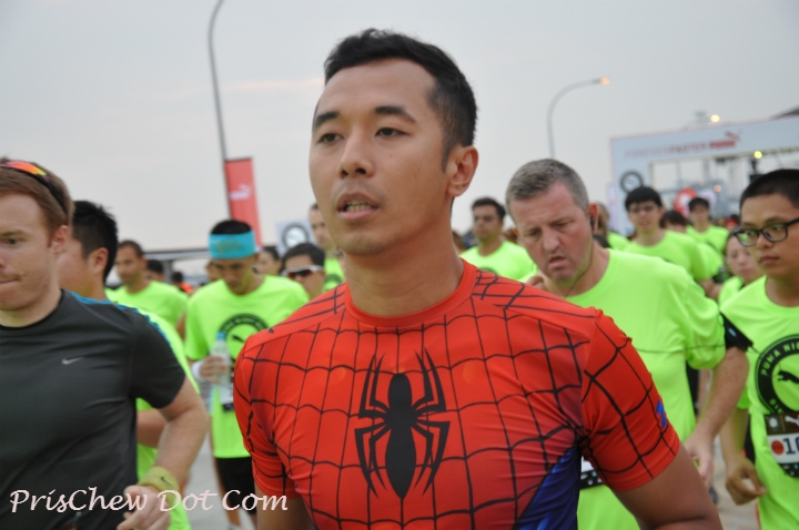 Another runner wears a SpiderMan compression top to compete.
