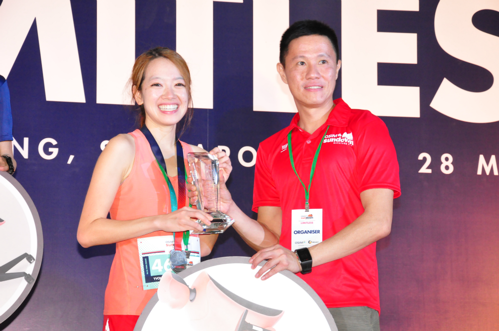Adrian Mok, seen here presenting a prize to a winner, was happy with how the race went.