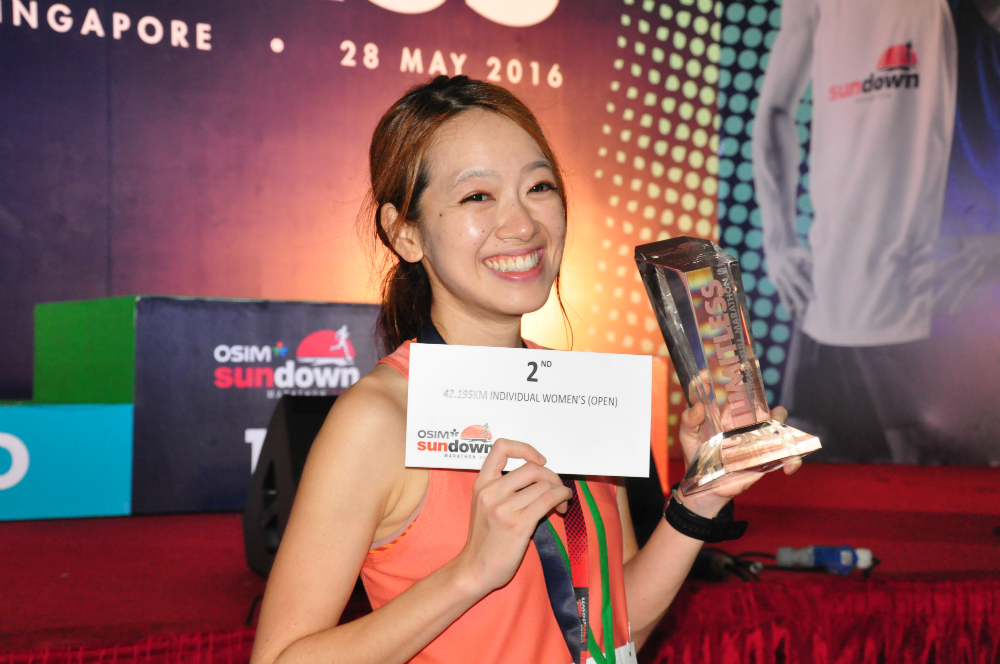 A smiling Yvonne Siew, who came 2nd in the Women's Full Marathon category.