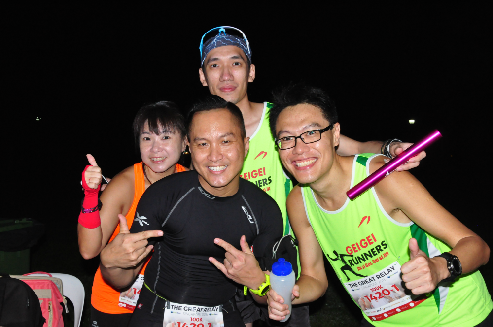 Runners are smiling at the camera.