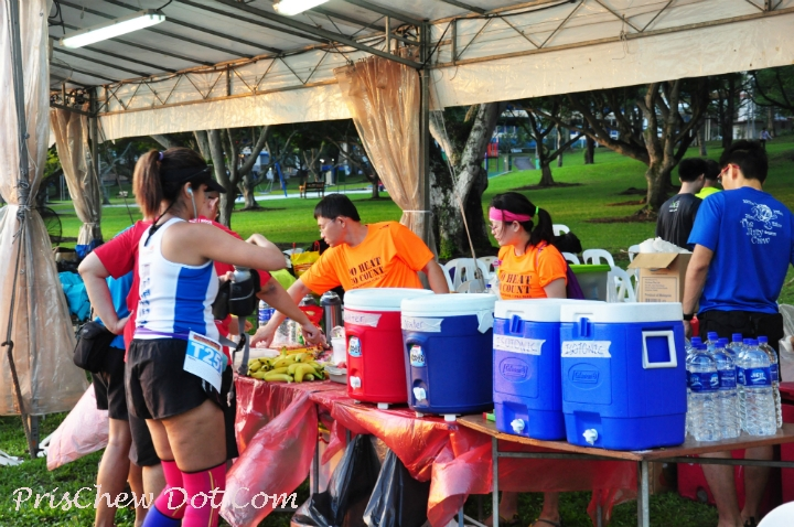 A runner helps herself to the refreshments in between her loops.