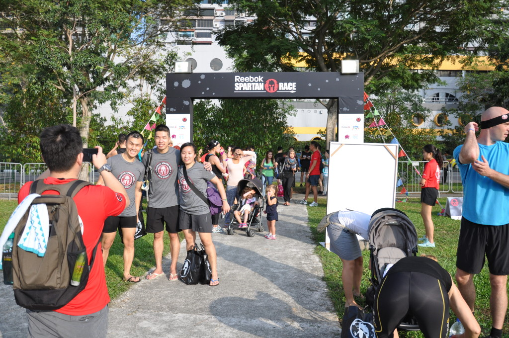 Participants take a photo before entering the Spartan race village.