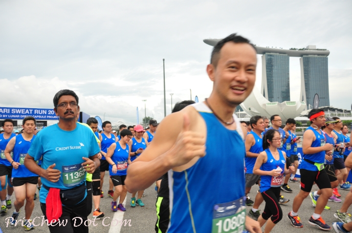 Runners pass the iconic Marina Bay Sands.