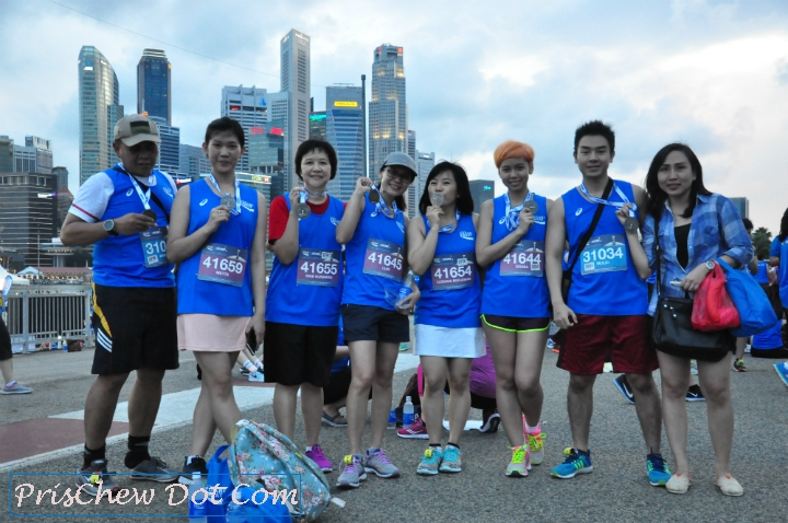 Runners pose with their medals.