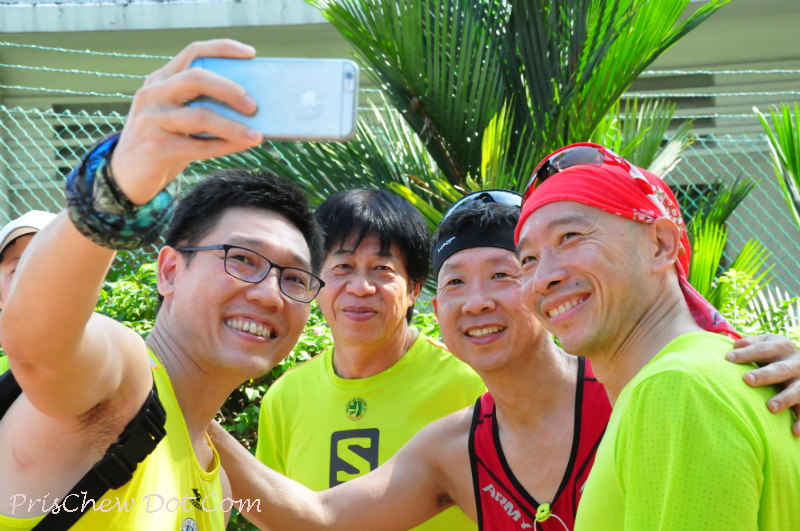 Runners take a selfie.