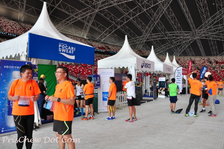 Runners check out the activity booths.