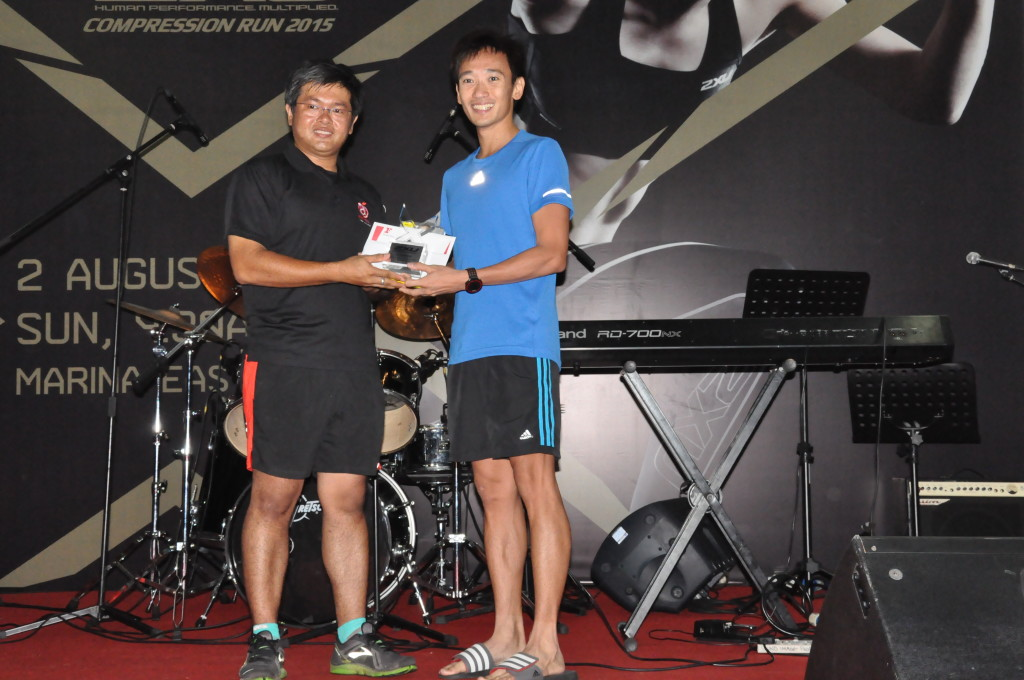 Melvin Wong collects his prize.