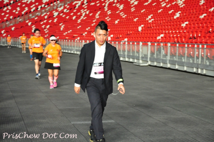 A runner wears a business suit.
