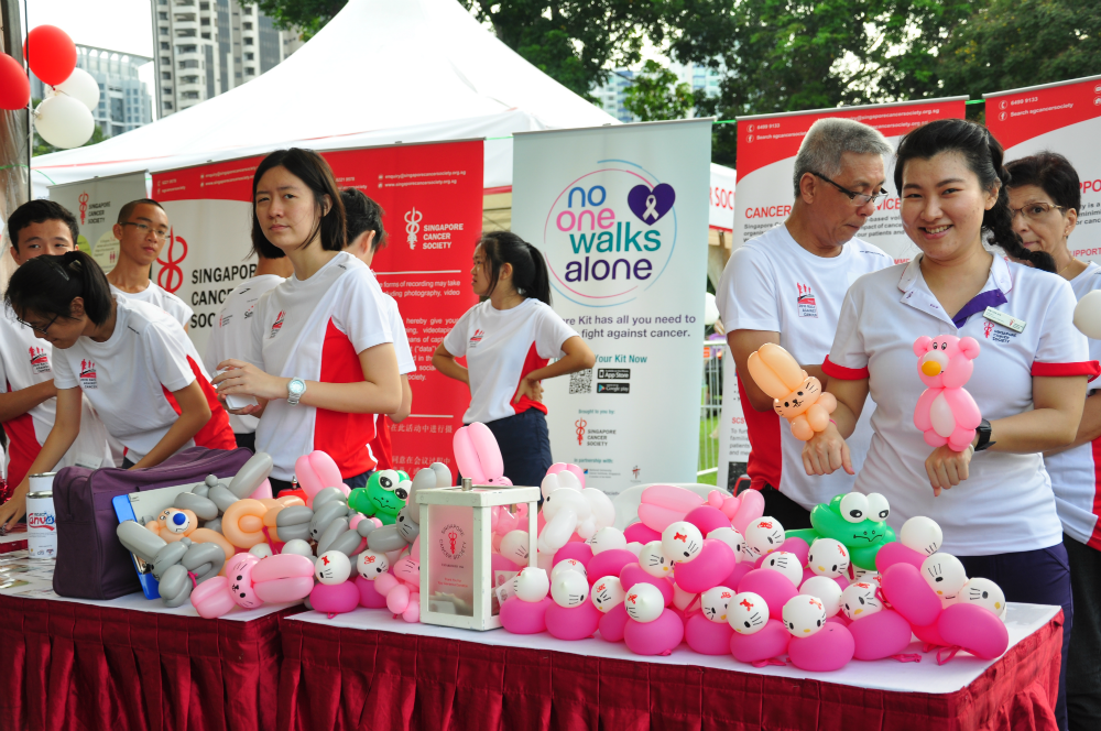 Giving out balloon animals made by cancer patients and survivors was a meaningful gesture.