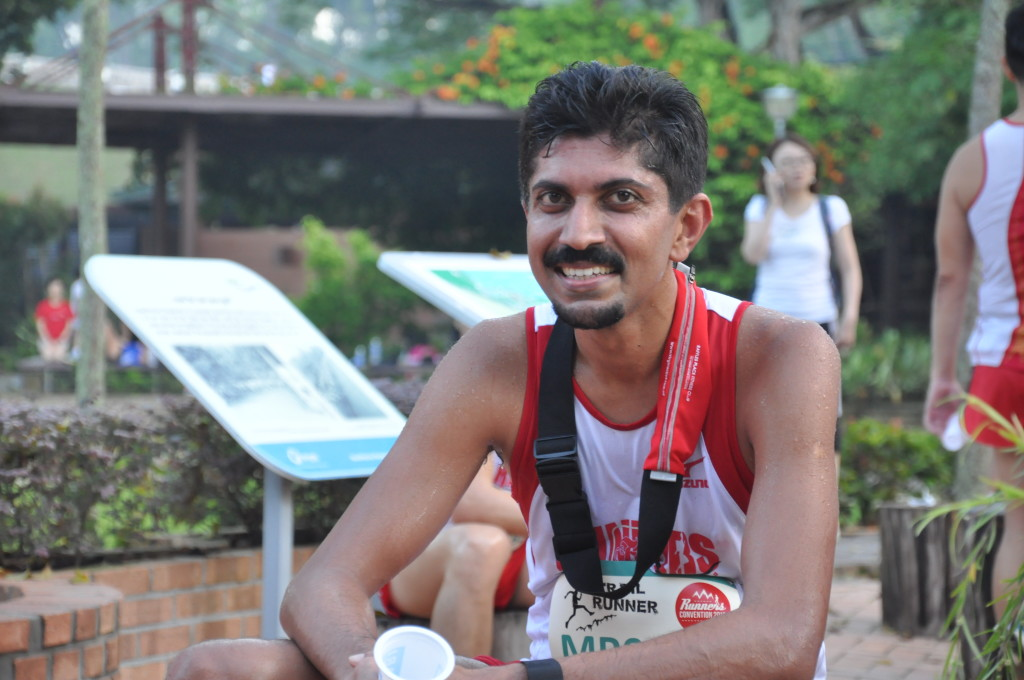A runner relaxes after completing his run.