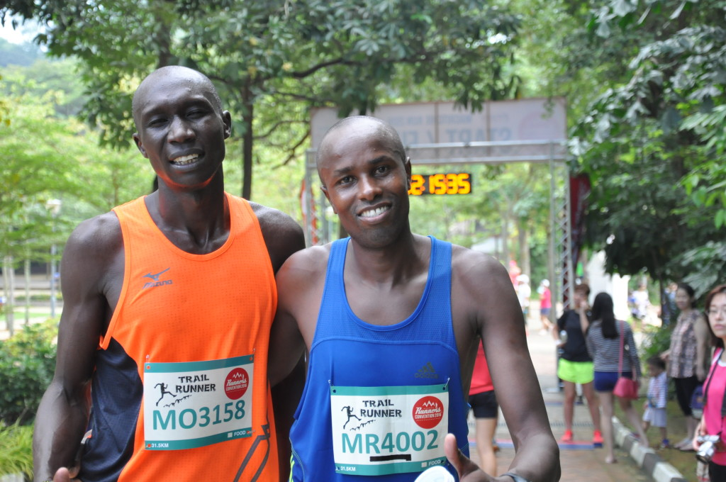 Runners smile for the camera.
