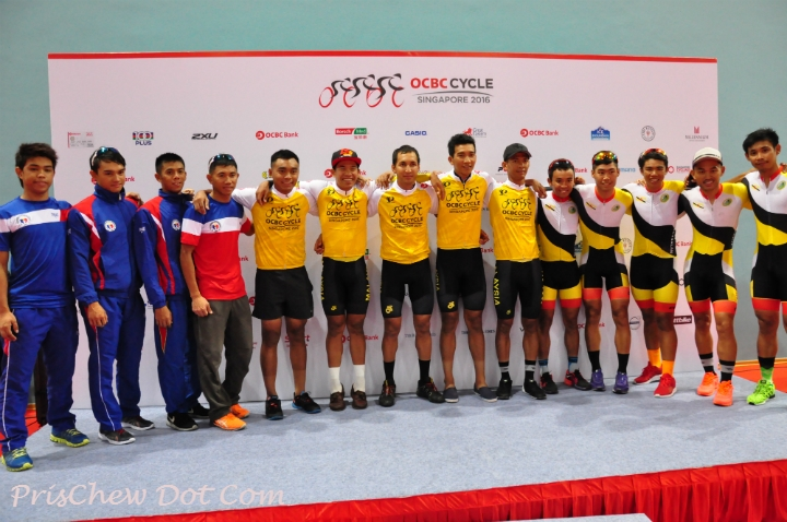 Team Philippines (left in blue), Team Malaysia (centre in yellow), and Team Brunei (right in yellow), posing for a group photo after the victory ceremony of the OCBC Cycle Southeast Asia Speedway Championship at Singapore Sports Hub.