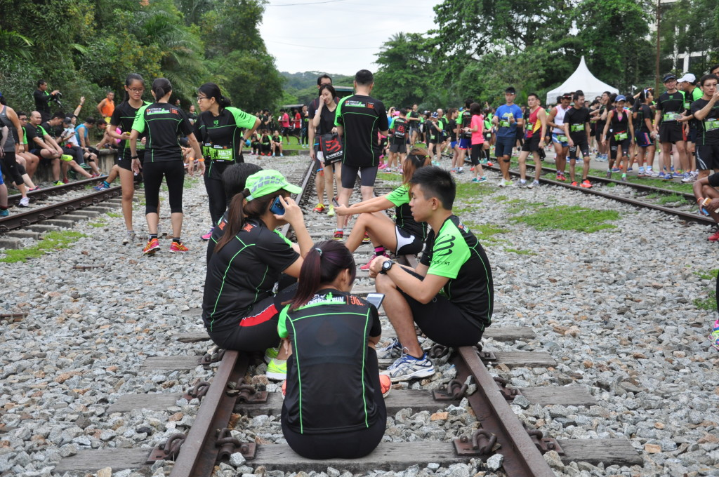 Runners chill out at the starting line at Bukit Timah.
