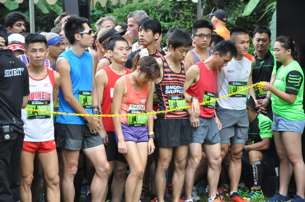 Runners in the start pen wait for the race to start.