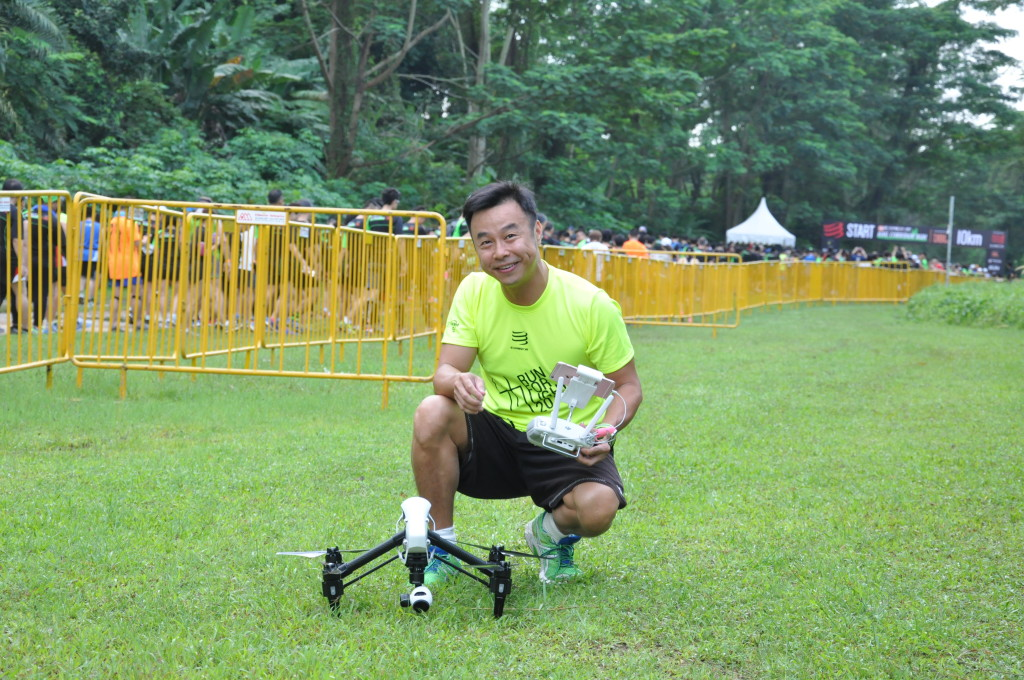 The pilot prepares the remote-controlled drone before it lifts off into the air.
