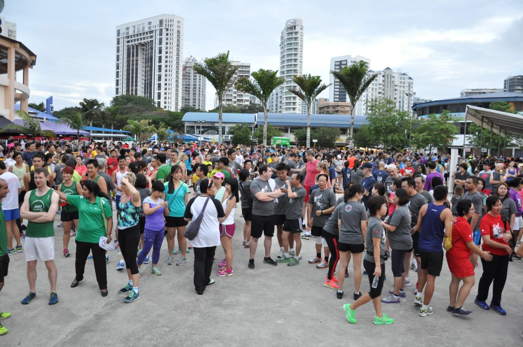 Runners mingle around at the start line before the run.