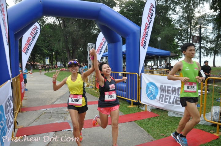 Crossing the finish line in a new personal best time!