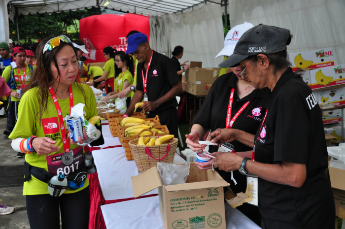 A runner collects food after the race.