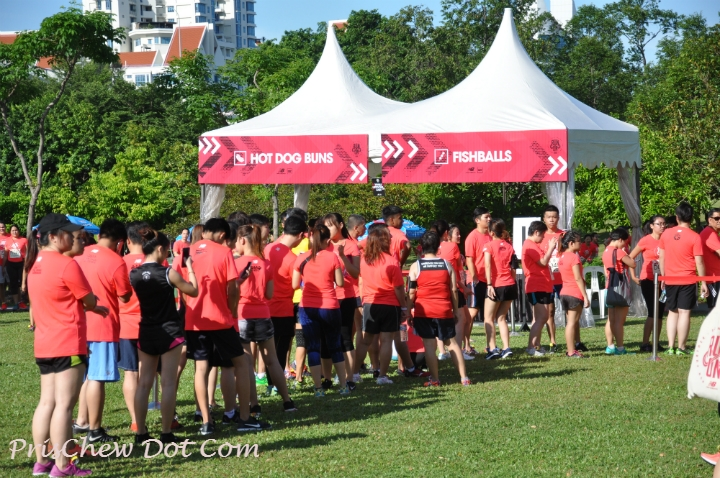 Runners queue for food before the race begins.