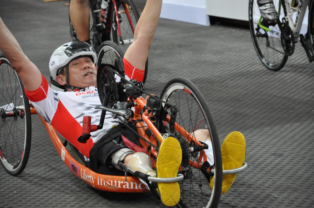 The hand cyclist is happy to cross the finish line!