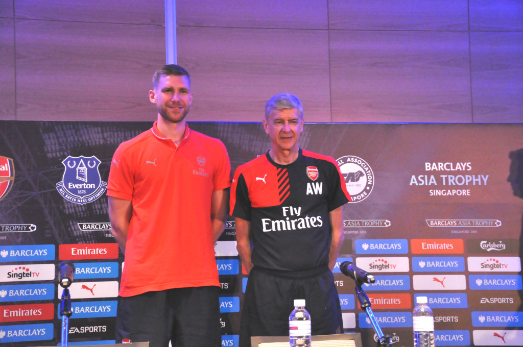 Arsenal defender Per Mertesacker and manager Arsene Wenger.