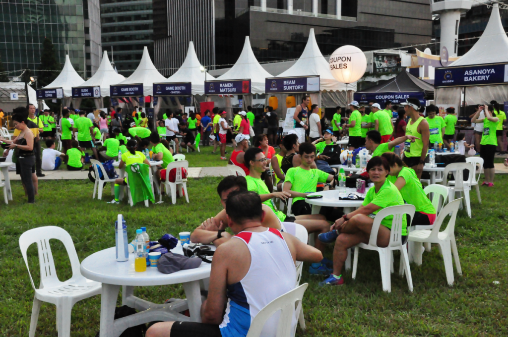 Runners indulge in Japanese goodies at the finish line.