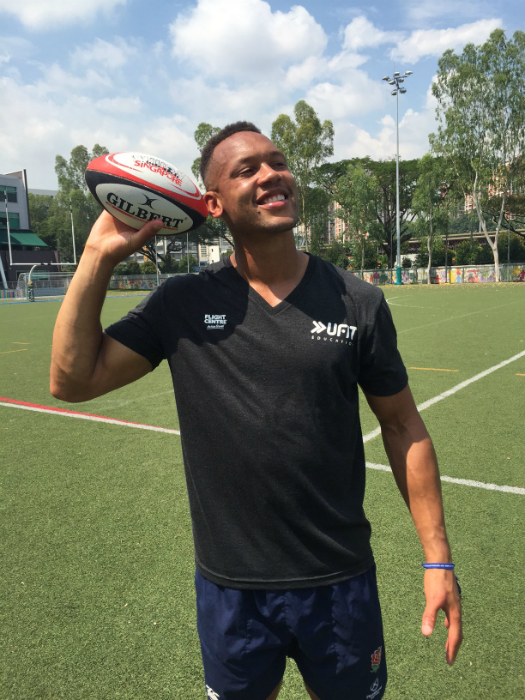 Dan Norton conducting a grassroots rugby clinic at Australian International School in Singapore (Photo Courtesy of Rugby Singapore and UFIT Education)