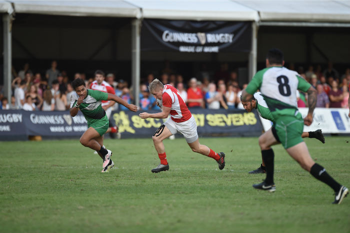 Player of the Cup Final, Cameron Cowell, evades the attention of the Sunnybank defence as he attempts a try at the 69th edition of the Singapore Cricket Club International Rugby Sevens Cup Final. (Photo Credit SCC 7s)
