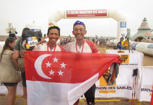 The Singapore duo at the finishing line with the national flag.