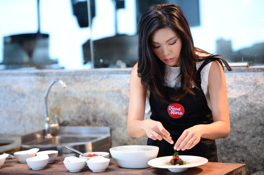 Debbie applies the final touches to her Wagyu Beef dish. (Credit to: Scripps Networks Interactive).