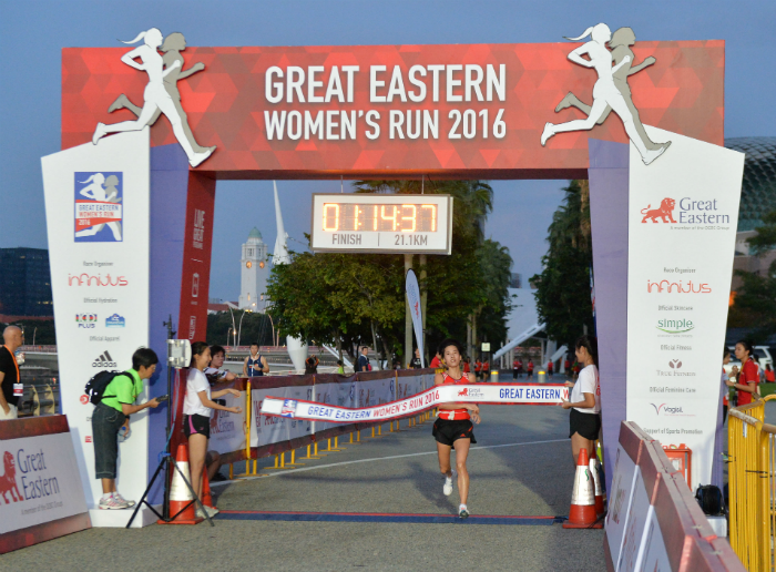 Jo Un Ok from the Democratic People's Republic of Korea breaks the finish tape (Photo credit to Great Eastern Women's Run)