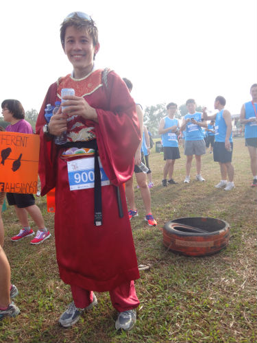 Gerrard Lim with his 9kg tyre behind him, at the MediaCorp Hong Bao Run 2014.