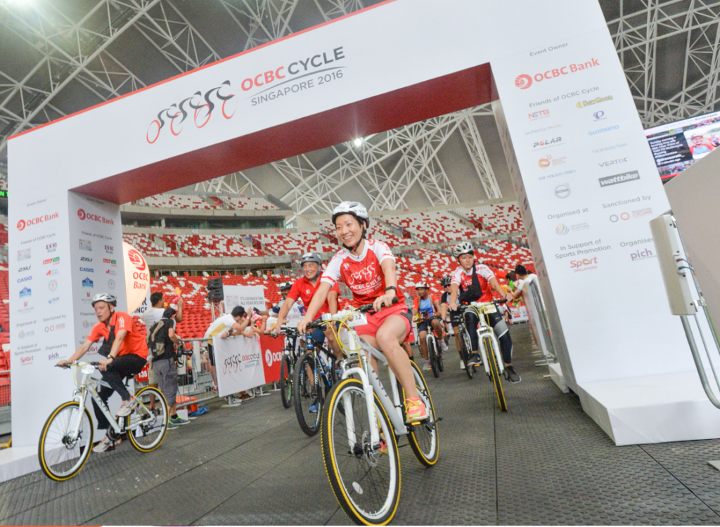 Grace Fu, Minister for Culture, Community and Youth, pedals in at the end point of OCBC Cycle 2016 at the National Stadium. She took part in the 23km Straits Times Ride. (Photo Credit: OCBC Cycle)